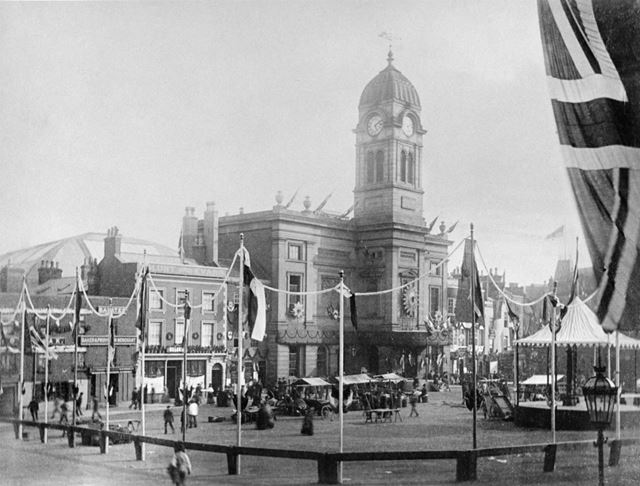 Market Place and Guildhall decorated for the royal visit of The Prince of Wales Prince Edward and Pr