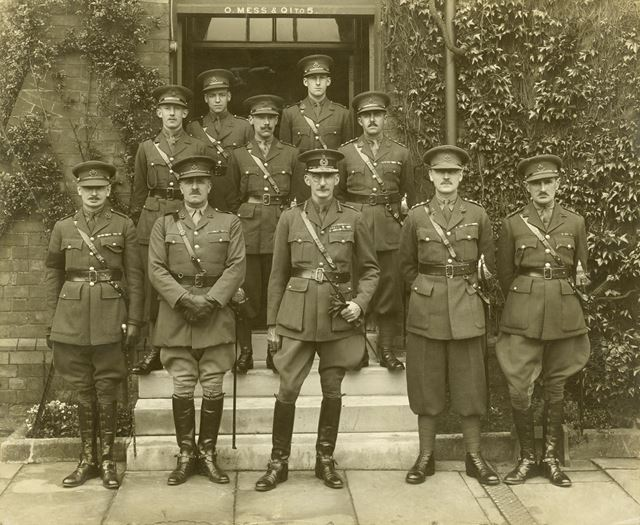 Group of Officers outside the Officer's Mess, Normanton Barracks (during or around World War 1?) mos
