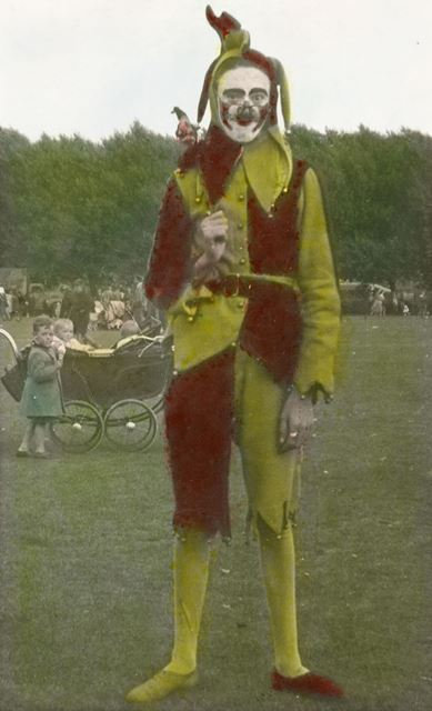 Derby Carnival Jester, Mr M A Poulson, holding a Jesters fun stick with the head of Punch on the top