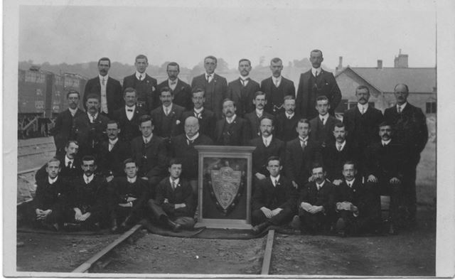 Posed Railway Workers with Shield