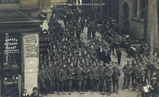 World War 1? Soldiers in street.