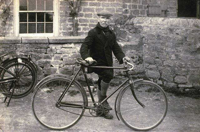 Mr Bowskill and his bicycle, outside the Half Moon pub, Whitwell, c 1930's
