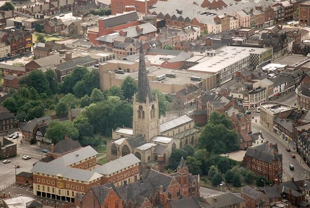 Aerial View of the Crooked Spire of Parish Church of Saint Mary and All Saints and surrounding stree