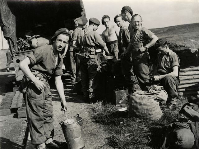 Soldiers cooking by a roadside in the Peak District, c 1940s ?