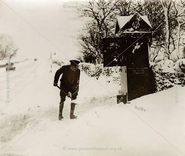 AA patrolman digging snow, Fox House Inn, Longshaw, 1935