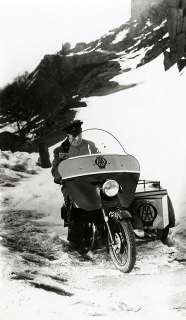AA patrolman and motorcycle combination, Peak District, c 1955