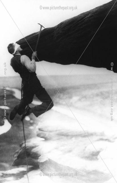 A climbing stunt on Pillar Rock, Black Rocks ?, Cromford ?, c 1940s