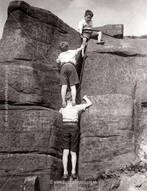 Three small boys on Burbage Rocks, Hathersage, 1935