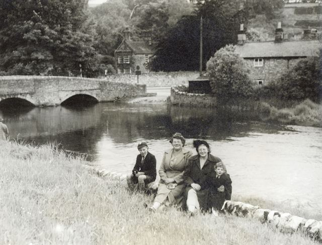 River Wye and Sheepwash Bridge with family group, Ashford in the Water, c 1950s ?