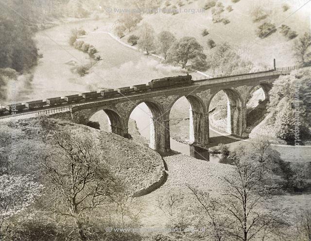 Goods train crossing the railway viaduct, Monsal Dale, c 1940s ?