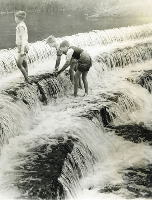 Boys paddling on a weir on the River Wye, Monsal Dale, c 1930s ?