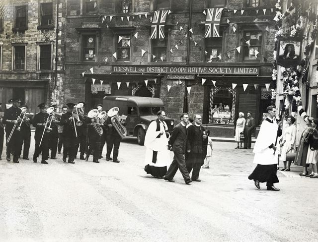 Procession passing the Tideswell and District Co-operative Society shop, Tideswell, c 1945 ?