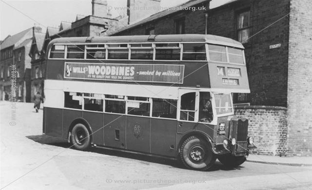 Midland General Omnibus parked on street
