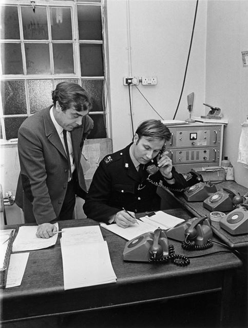 Derbyshire County and Borough Police sub-division control room. S.C Philip Ward and Civilian Jerry B