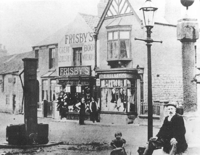 The Cross and village water pump, Clowne, c 1900s