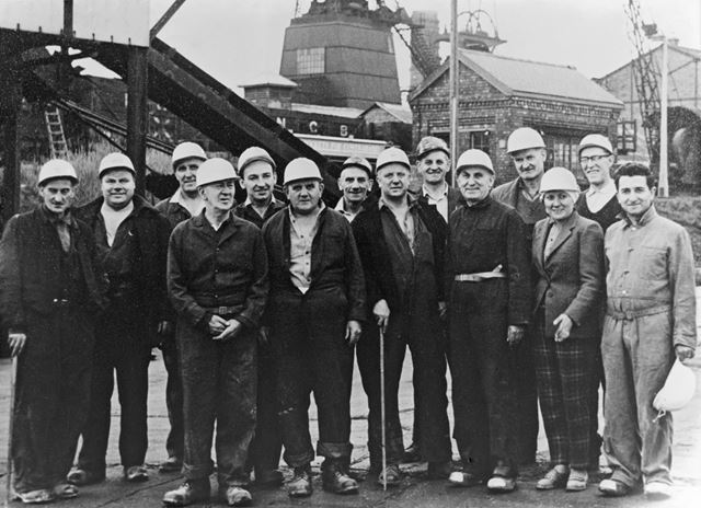 Group of miners and officials at Bolsover Colliery
