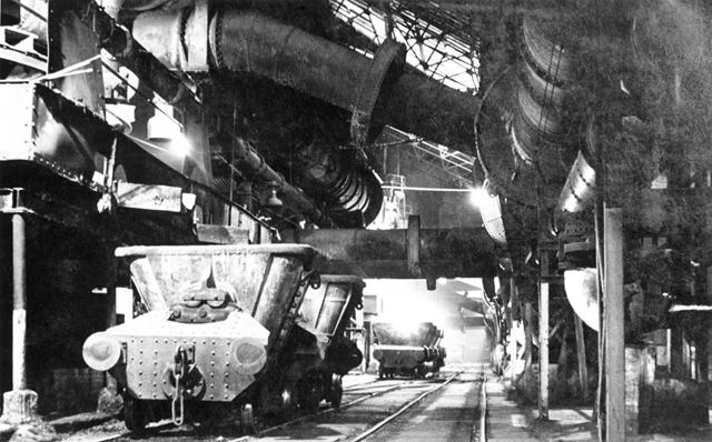 Molten-iron or hot slag wagons being filled from the tapped blast-furnaces