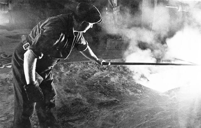 Molten-iron or steel being tapped castings in the sand