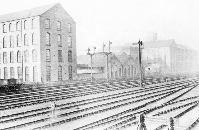 Lace and hosiery factories alongside the Erewash Valley railway line, Ilkeston Junction, Ilkeston, c