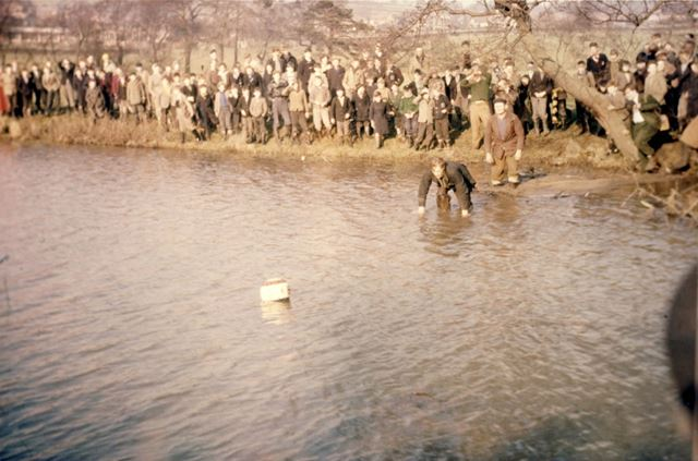 Shrovetide Football Game: The ball has gone in the water