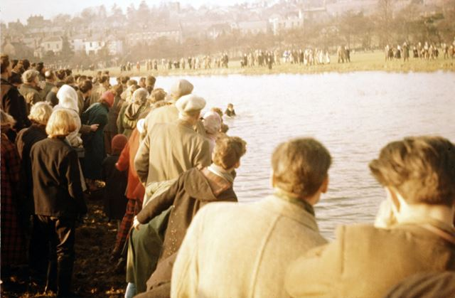 Shrovetide Football Game: Retrieving the ball which has gone in the water