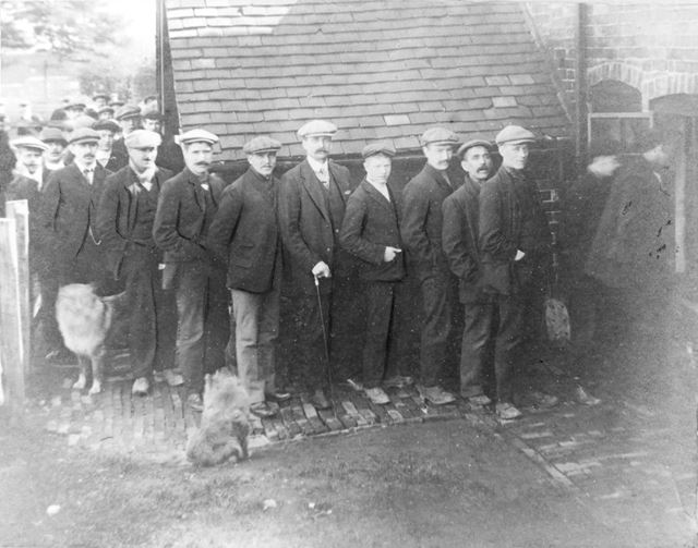 Coal Miners receiving their first strike pay 1912