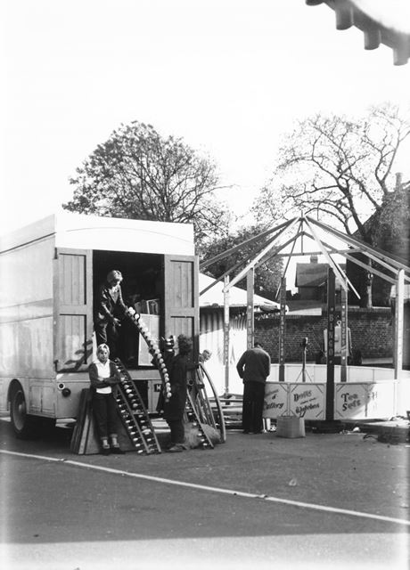 Ilkeston Fair - Showmen and women erecting a sideshow at the NE corner of the Market Place, outside