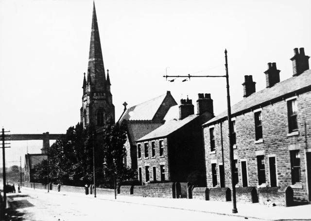 Dinting Vale Road showing Dinting Holy Trinity Church