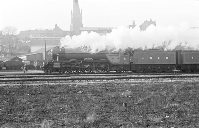 The 'Flying Scotsman' passing Chesterfield's 'crooked spire', on its return from America