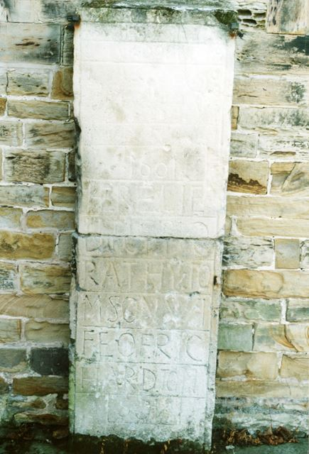 Stone set into the wall of St Peter and Paul church, Eckington