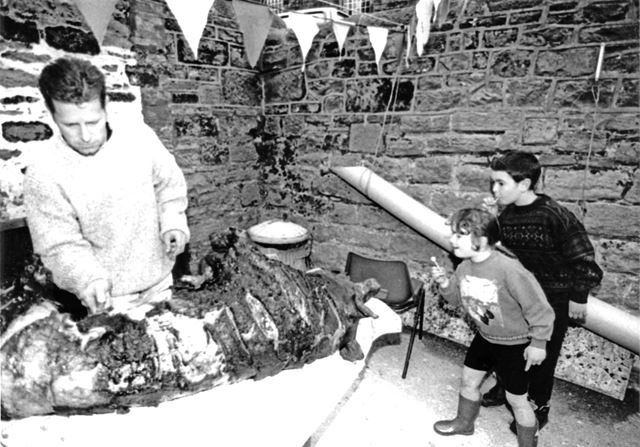 Children intrigued by the hog roast, Fritchley Festival