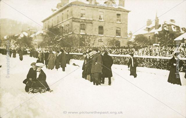 Tobogganing outside the Clarendon Hotel, c 1906
