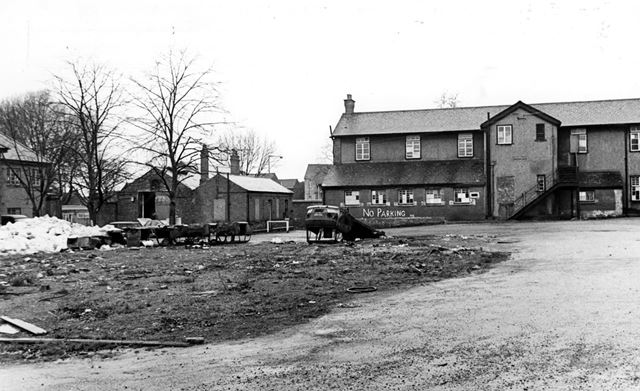 Derelict barracks and burnt out cars