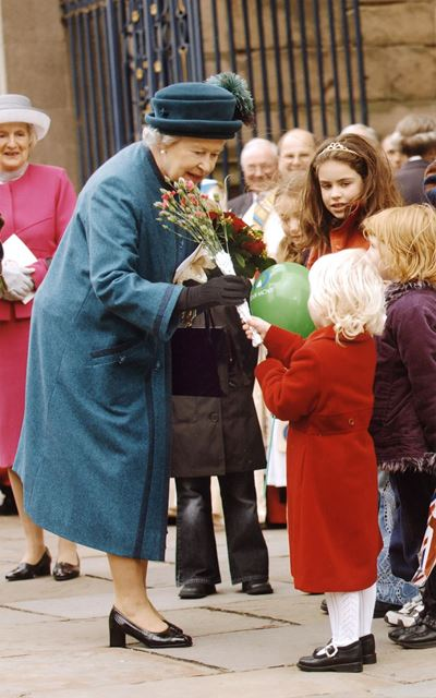 The Queen receiving flowers outside Derby Cathedral