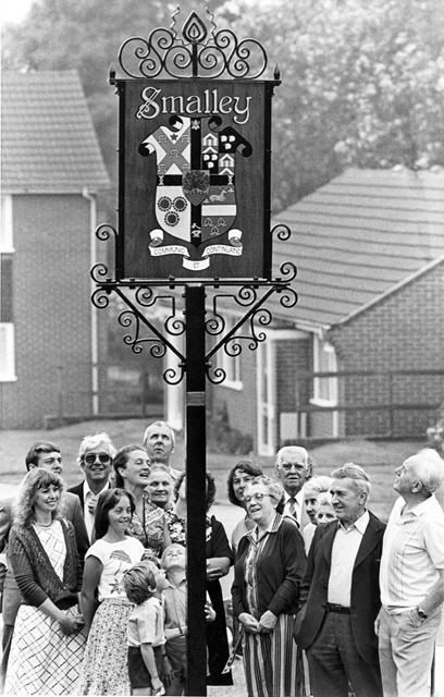Local residents gathered around the village signpost, Smalley
