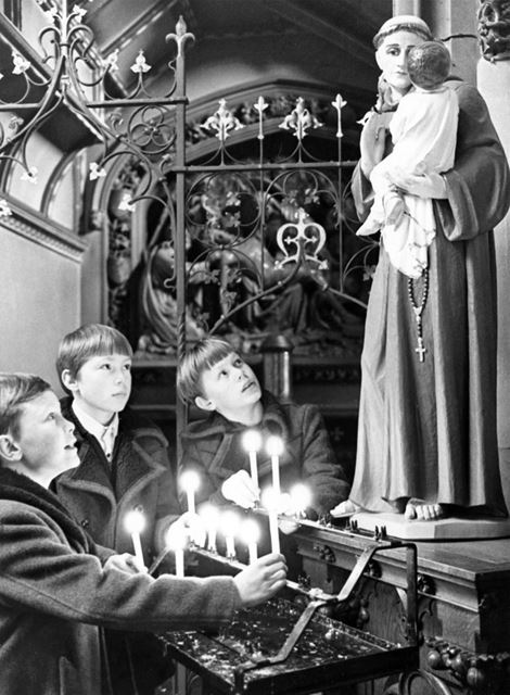 St Mary's RC Church - Children light candles at midnight mass to celebrate the new year