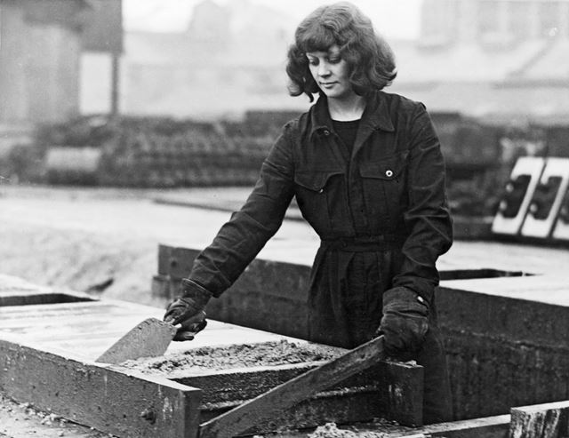 A woman worker making concrete railway sleepers, employed by LNER, Derby, during World War 2